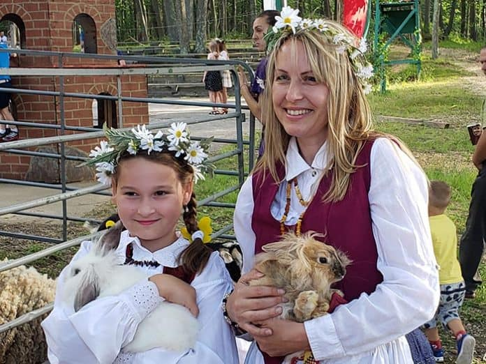 Attendees of the 10th Annual Lithuanian Festival enjoy a petting zoo provided by the Honkey Tonk Ranch. (Photo by Bob Vosseller)