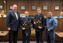 From left to right, Lacey Township Mayor Timothy McDonald, Lanoka Harbor Fire Company President Edward Barker, Forked River Firefighter Edward Barker, Jr., and Police Chief Michael C. DiBella, during the July 11, 2019 Lacey Township meeting. The police department recognized the efforts of both men related to a December 2018 water rescue. (Photo courtesy Lacey Township Police)