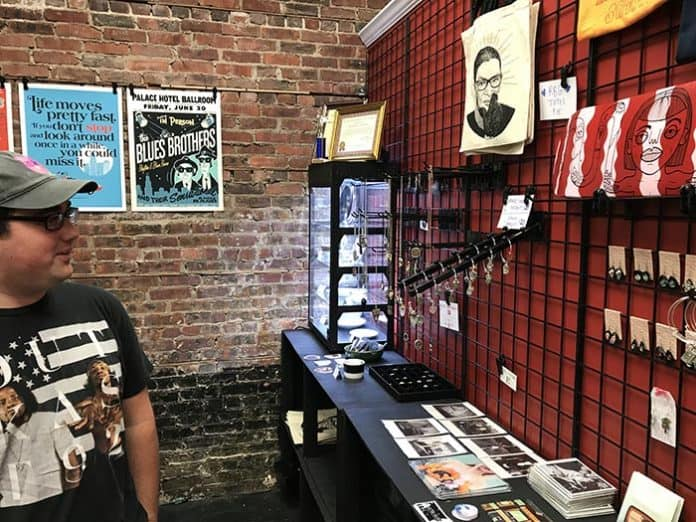 Jimmy Mura shows off punk and pop culture-themed items in the shop at 53 Main Street (Route 9 in downtown Toms River). (Photo by Chris Lundy)