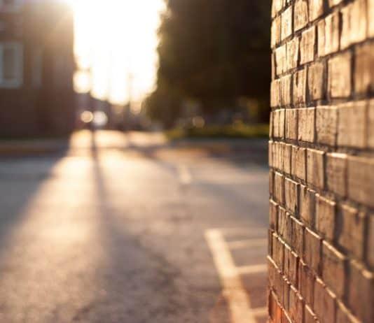 Brick wall and street. (File photo)