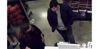 Surveillance footage shows the woman and man making a purchase at the Nike Premium Outlet in Jackson. (Photo courtesy NJSP)