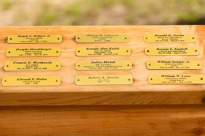 The brass plaques provided by Ironbound Trophy Center of Newark. (Photo by Jennifer Peacock)