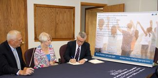 Participating in the signing of the Memorandum of Understanding are from left to right Ocean Mental Health Services Chief Executive Officer James M. Cooney, Ocean County Freeholder Director Virginia E. Haines, and New Jersey Reentry Corporation Executive Director Jim McGreevey. (Photo courtesy Ocean County)