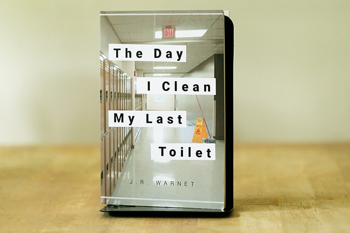 """The Day I Clean My Last Toilet,"" a novel by J.R. Warnet. (Photo by Jennifer Peacock)"